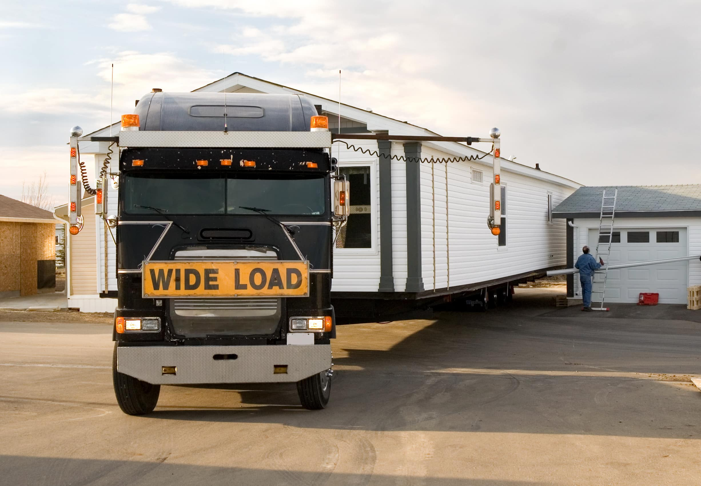 Semi-Truck backing in a mobile home.